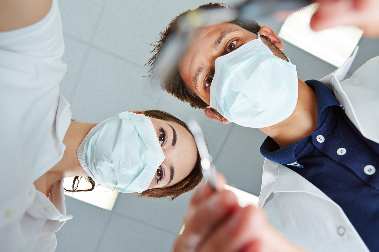 Patient POV of dentist and dental assistant during dental treatm
